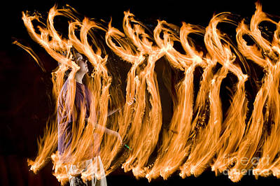 Biomechanic Photograph - Juggling Fire by Ted Kinsman