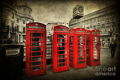 Photograph - 4 Red Phone Booths by Yhun Suarez