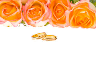 Photograph - 4 Red Yellow Roses And Wedding Rings Over White by Ulrich Schade