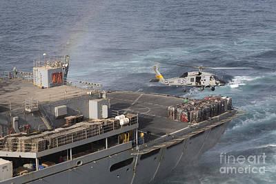 A Sh-60j Seahawk Conducts A Vertical Art Print by Gert Kromhout