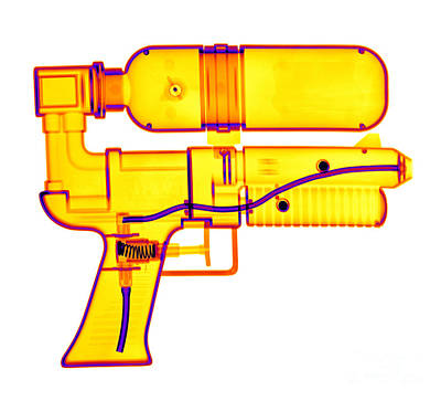 Photograph - An X-ray Of A Squirt Gun by Ted Kinsman