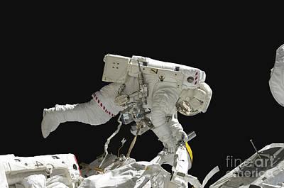Astronaut Working On The International Art Print by Stocktrek Images