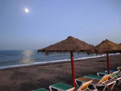 Photograph - Moon Light Beach Umbrellas And Chairs Costa Del Sol Spain by John Shiron