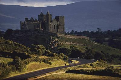 A Ancient Romanesque Castle Sits Atop Art Print by Cotton Coulson