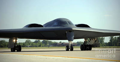 A B-2 Spirit Taxis Onto The Flightline Art Print by Stocktrek Images