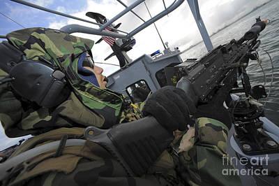 Integrated Photograph - A Boat Crewman Gunner Mans An M-240b by Stocktrek Images
