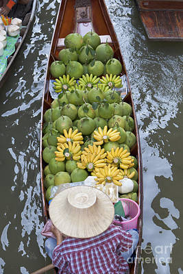 A Boat Laden With Fruit At The Damnoen Saduak Floating Market In Thailand Art Print by Roberto Morgenthaler