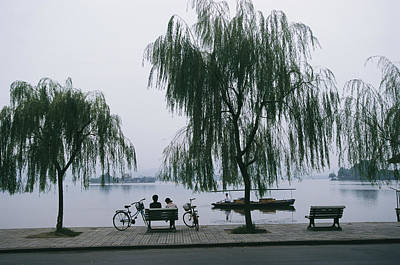 Willow Lake Photograph - A Boat Passes By Bicyclists On A Bench by James L. Stanfield