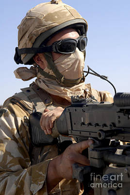Obscured Face Photograph - A British Army Soldier Mans A Machine by Andrew Chittock