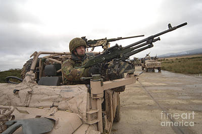 Pink Panther Photograph - A British Soldier Mans The Gun Mount by Andrew Chittock
