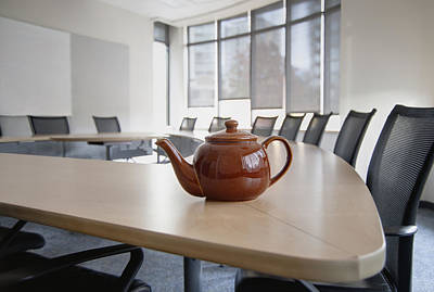 A Brown China Teapot On Boardroom Table Art Print by Marlene Ford