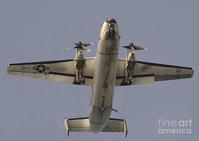 A C-2 Greyhound In Flight Art Print by Stocktrek Images