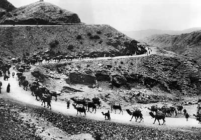 20st Century Photograph - A Camel Caravan On The Khyber Pass by Everett