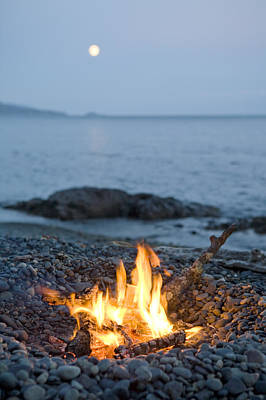 A Campfire On A Beach With A Full Moon Art Print by Taylor S Kennedy