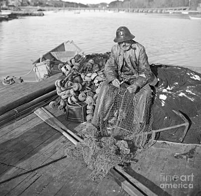 Rain Gear Photograph - A Cape Ann Fisherman In Gloucester 1905 by Padre Art