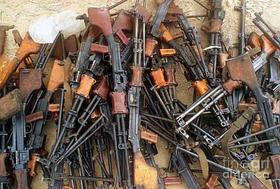 Kalashnikov Photograph - A Captured Fedayeen Weapons Cache by Stocktrek Images