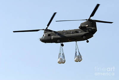 Netting Photograph - A Ch-47 Chinook Carrying Sandbags by Stocktrek Images