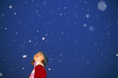 A Child Revels In Falling Snow Art Print