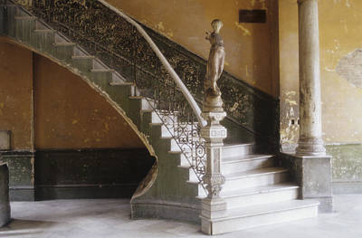 A Circular Marble Staircase And Statue Art Print by Kenneth Ginn
