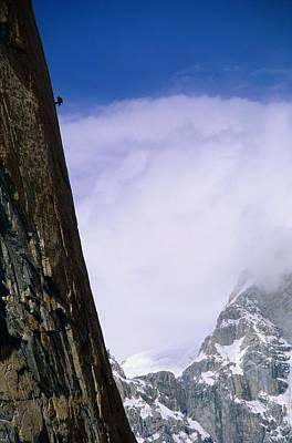 A Climber Rappels Down The Sheer Print by Bill Hatcher