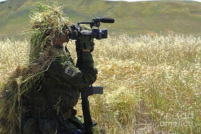 Videographer Photograph - A Combat Videographer Practices Evasion by Stocktrek Images