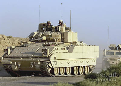 Photograph - A Convoy Of Bradley And Humvee Armored by Stocktrek Images