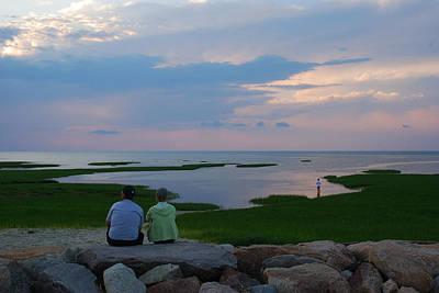A Couple Sit On A Rock Watching Sunset Art Print by Darlyne A. Murawski