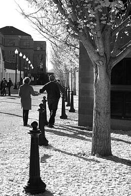 Photograph - A Couple Walking Together Holding Hands Downtown Asheville by Gray  Artus