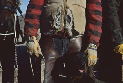 A Cowboy, Wearing A Ripped Jacket Art Print by Joel Sartore