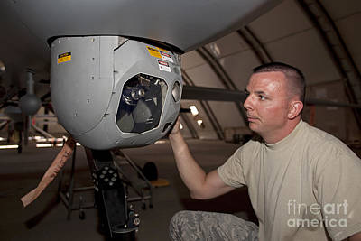 A Crew Chief Works On Mq-1 Predators Art Print by HIGH-G Productions