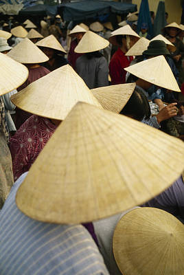Crowd Scene Photograph - A Crowd Of People In Conical Straw Hats by Justin Guariglia