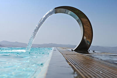A Curved Stainless Steel Water Fountain Art Print