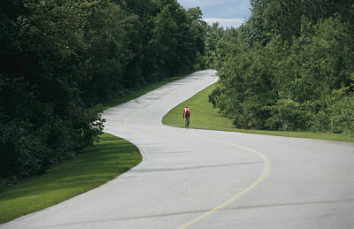 A Cyclist On A Scenic Drive In Gatineau Art Print