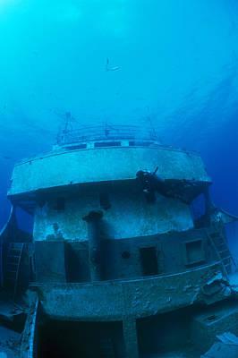 A Diver Exploring A Shipwreck Art Print by Nick Caloyianis