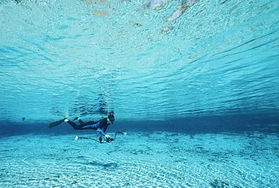 A Diver Swims Through Crystal Rivers Art Print by Raul Touzon