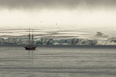 A Double-masted Sailboat Floats Near An Art Print by Norbert Rosing