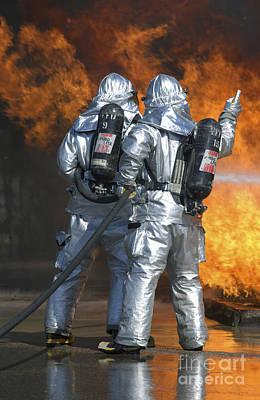 A Firefighter Fights A Fire Art Print