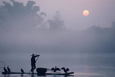 A Fisher Uses Cormorants To Capture Art Print by Kenneth Ginn