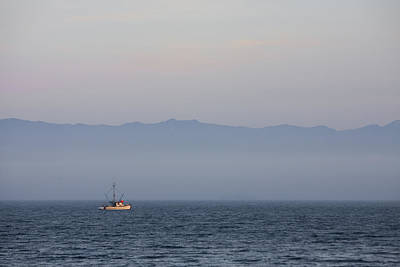 A Fishing Boat Sails Along At Sunset Art Print by Taylor S. Kennedy