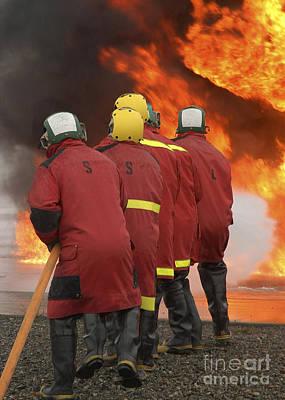 A Flight Deck Fire Party Battles Art Print by Stocktrek Images