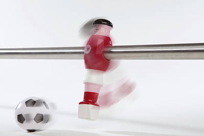 Anthropomorphic Photograph - A Foosball Figurine Kicking A Soccer Ball, Blurred Motion by Caspar Benson