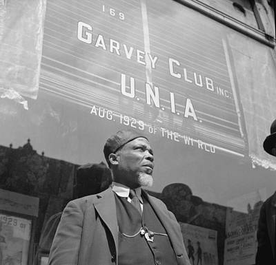 1940s Storefront Photograph - A Garveyite In Front Of The Garvey Club by Everett