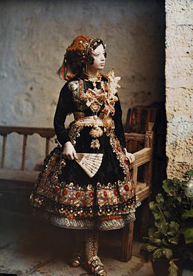 Looking Away From Camera Photograph - A Girl Poses In Her Traditional Costume by Gervais Courtellemont