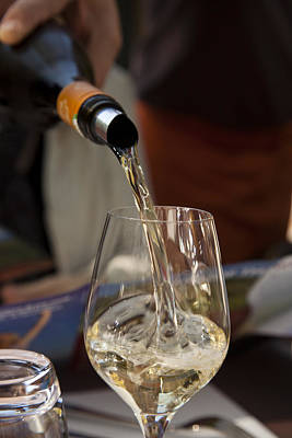 Pouring Wine Photograph - A Glass Of White Wine Being Poured by Taylor S. Kennedy