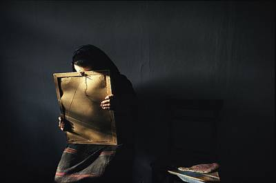 A Grieving Woman Holds A Photograph Art Print