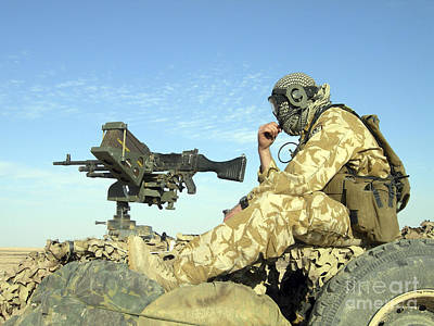 Obscured Face Photograph - A Gunner Sits Atop A British Army Wmik by Andrew Chittock