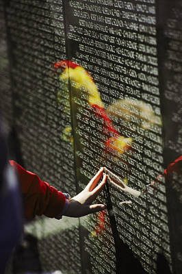 War Monuments And Shrines Photograph - A Hand Reaches Out To Touch A Name by Steve Raymer