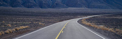 A Highway Curving Through Desolate Area Art Print by Greg Probst
