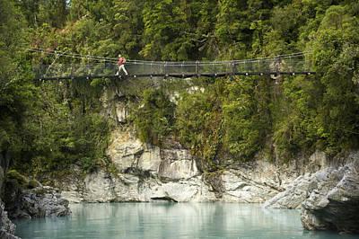 A Hiker On A Swing Bridge Art Print