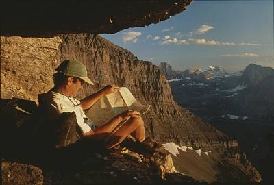 A Hiker Pauses To Rest And Read A Map Art Print